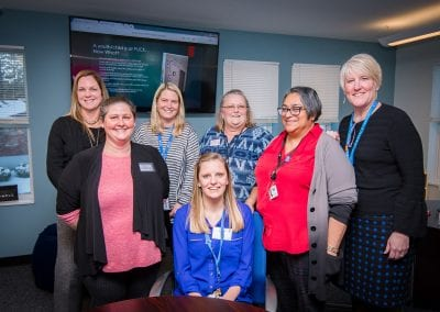 Group photo of United Counseling Service Staff in the PUCK space inside Youth and Family Services Center, Bennington, Vermont.