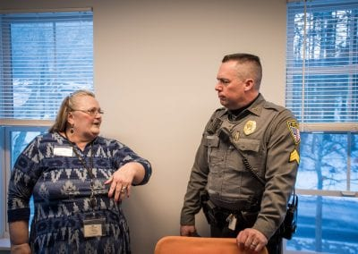 An UCS counselor chats with an officer of the Bennington Police Department at the PUCK Open House, January 2020