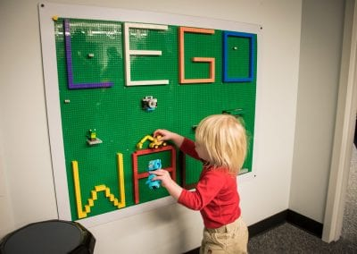 A young guest interacts with the Lego wall, one of PUCK's many therapeutic items, at the open house in January 2020.
